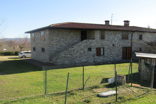 Portion of farmhouse in Poppi with private garden